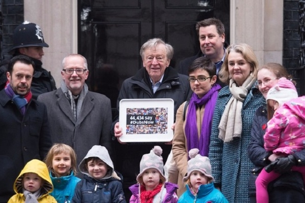Lord Dubs presenting a petition to Number 10